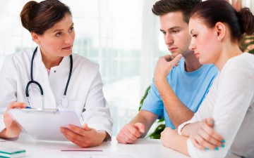 bigstock-Doctor-Consults-A-Young-Couple-35703737